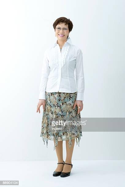 Portrait of senior woman, full length