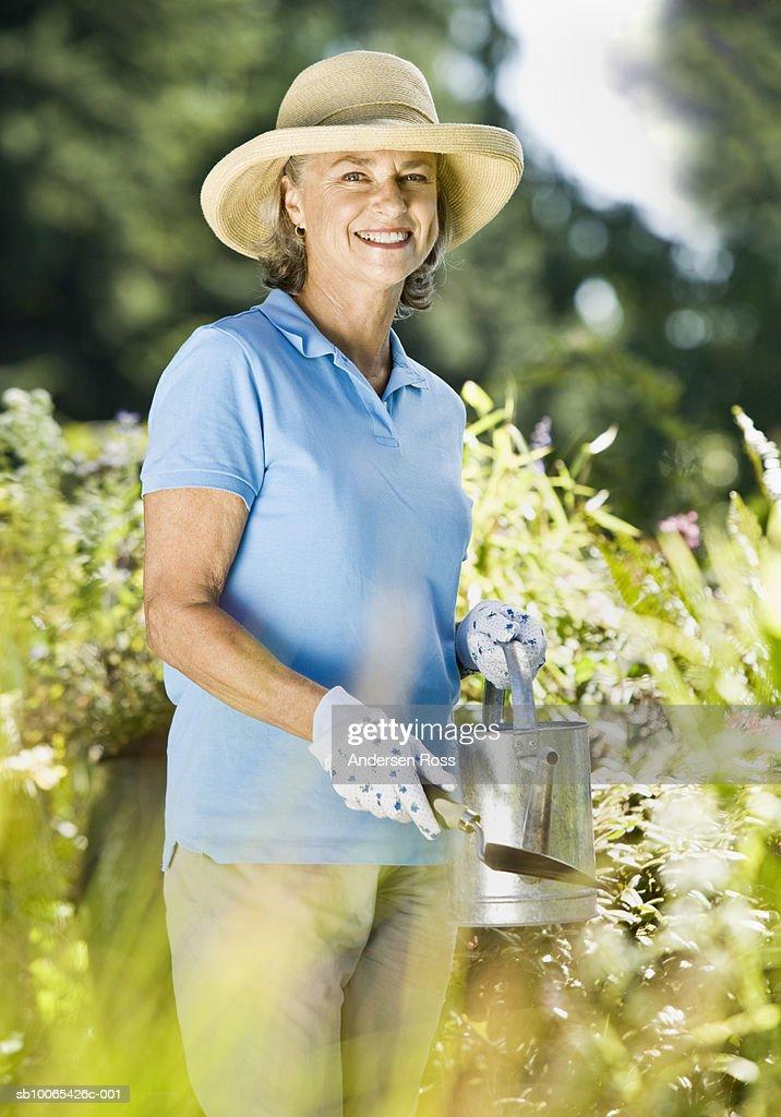 Portrait of senior woman gardening : Foto stock