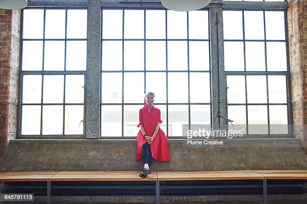 Portrait of senior woman in a big loft space