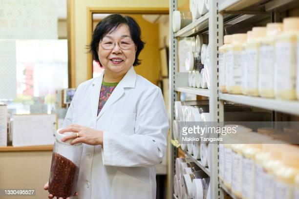 portrait of senior woman in a chinese medicine office - saitama prefecture stock pictures, royalty-free photos & images