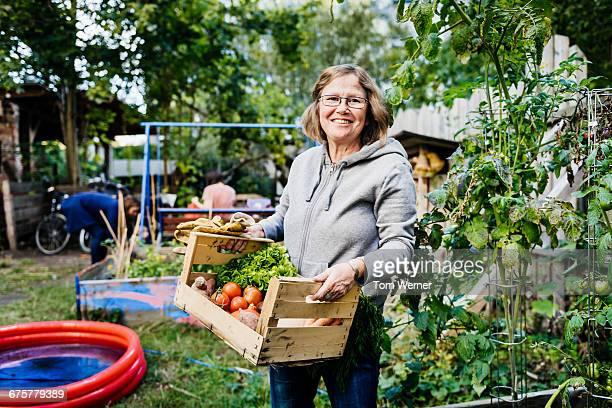 Portrait of senior woman in community garden