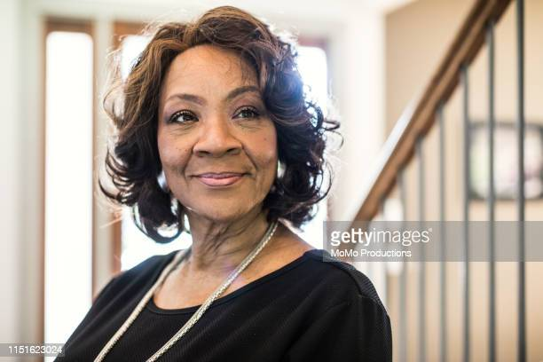 portrait of senior woman in hallway of home - african american ethnicity stock pictures, royalty-free photos & images