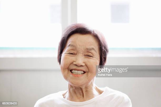 Portrait of senior woman in her 80's smiling at home