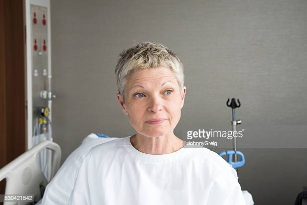 Portrait of senior woman in hospital wearing gown
