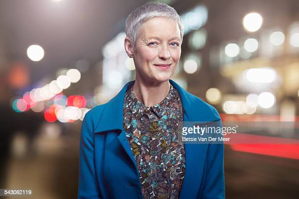 portrait of senior woman in urban city at night. - short hair stock pictures, royalty-free photos & images