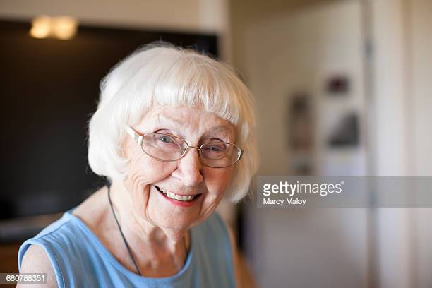 Portrait of senior woman, indoors, smiling