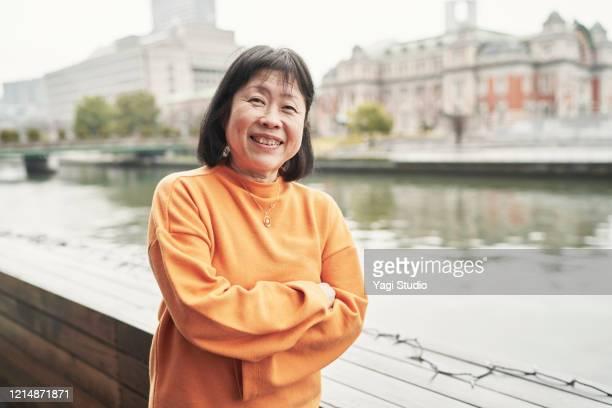 portrait of senior woman on cafe terrace - 女性 ストックフォトと画像