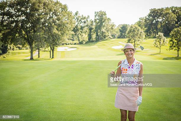 Portrait of senior woman on golf course
