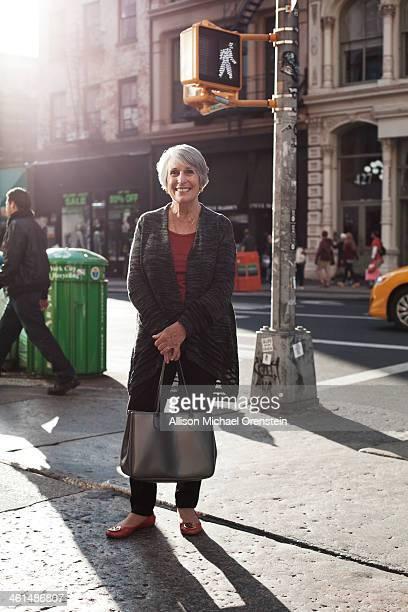 portrait of senior woman on street corner in city