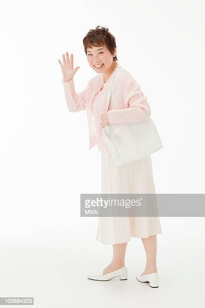 portrait of senior woman - 手を振る ストックフォトと画像