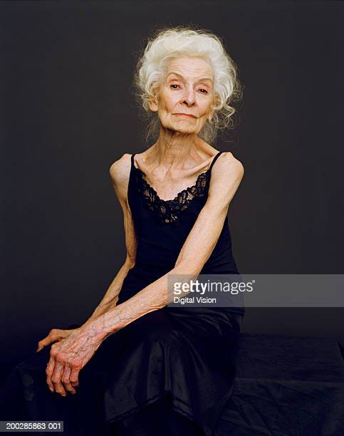 portrait of senior woman - thin stock pictures, royalty-free photos & images