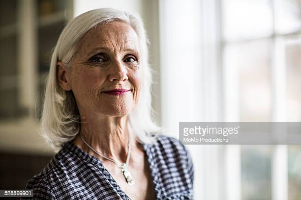 portrait of senior woman - leanincollection stock pictures, royalty-free photos & images