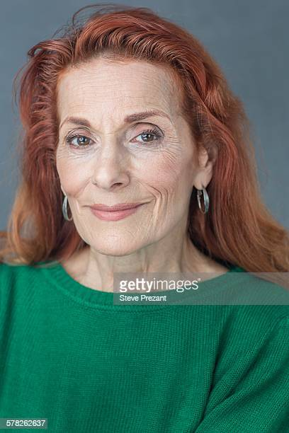 portrait of senior woman - older redhead stock pictures, royalty-free photos & images