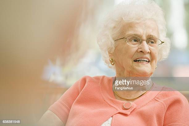 Portrait of senior woman smiling in nursing home
