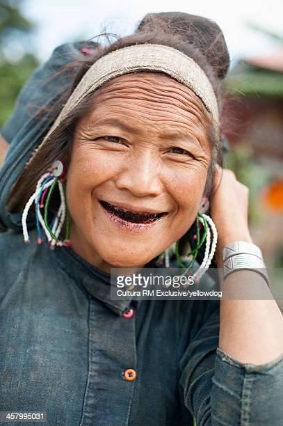 Portrait of senior woman smiling, Shan State, Keng Tung, Burma
