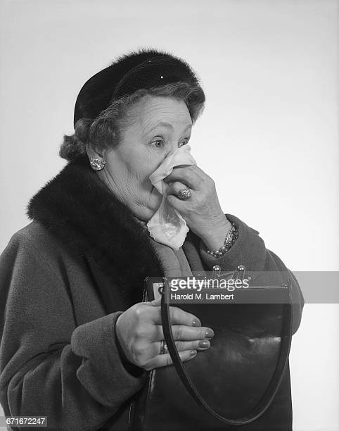 portrait of senior woman suffering from cold and flu - cold and flu stock pictures, royalty-free photos & images