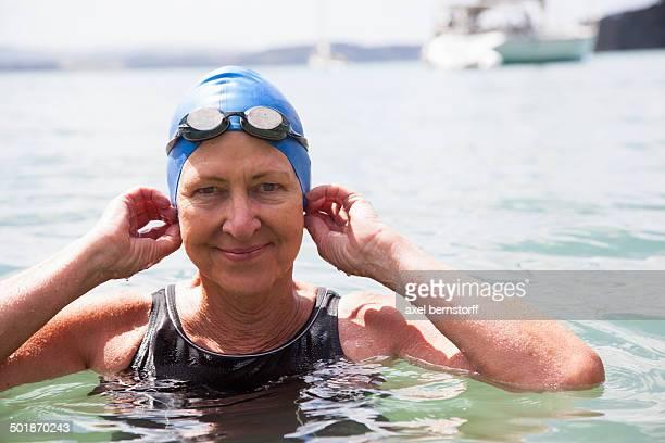 Portrait of senior woman swimmer in sea