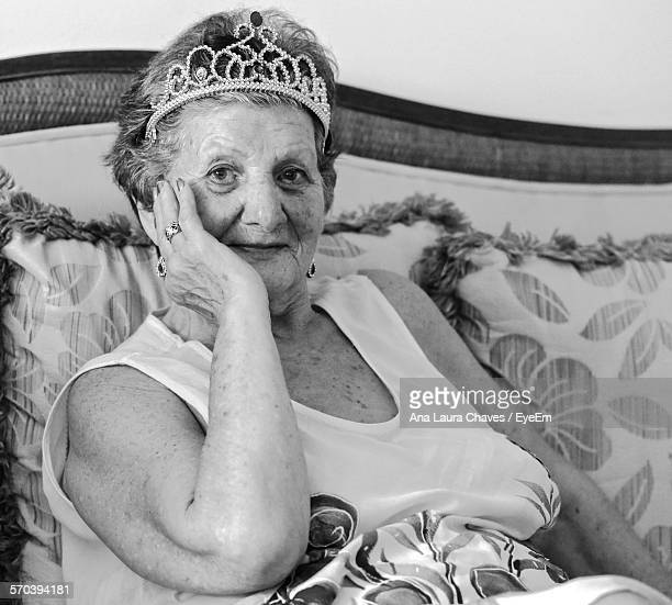 Portrait Of Senior Woman Wearing Crown At Home