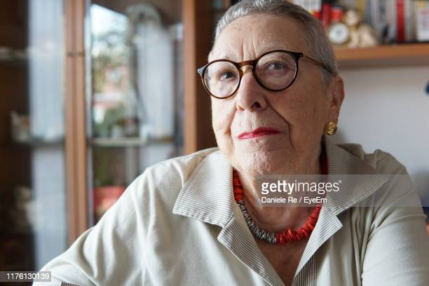 portrait of senior woman wearing eyeglasses at home - one senior woman only stock pictures, royalty-free photos & images