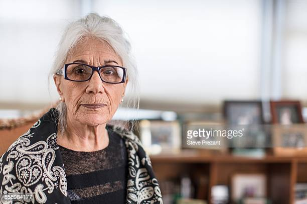 Portrait of senior woman wearing eyeglasses at home