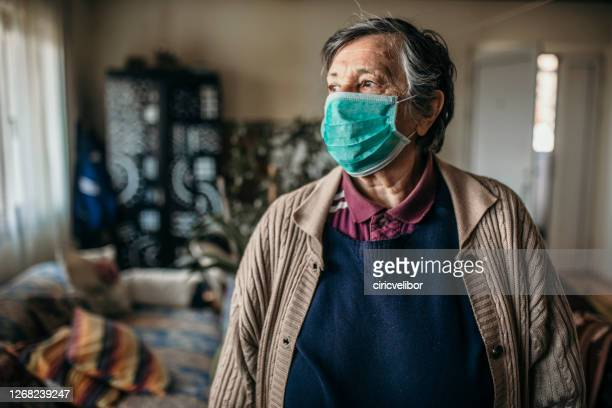 portrait of senior woman with face mask - serbia stock pictures, royalty-free photos & images