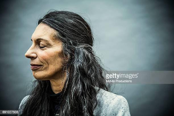 portrait of senior woman with long hair - leanincollection stock pictures, royalty-free photos & images