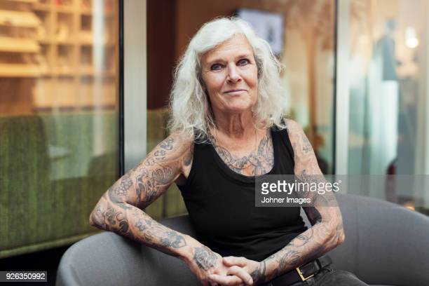 portrait of senior woman with tattoos - tattoo stock pictures, royalty-free photos & images