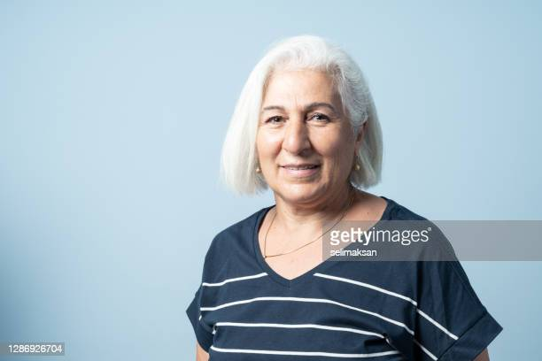 portrait of senior woman with white hair - middle east stock pictures, royalty-free photos & images