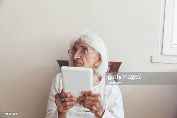 Portrait Of Senior Women Use Digital Tablet