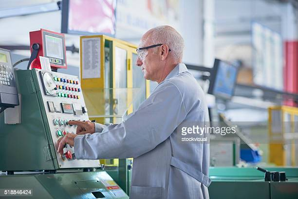 portrait of senior worker in factory - working seniors stock pictures, royalty-free photos & images