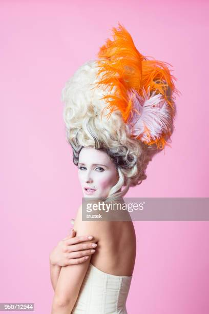 portrait of sensual baroque woman wearing wig, pink backgroud - baroque stock pictures, royalty-free photos & images