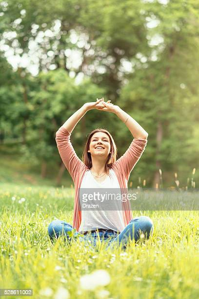 Portrait of sensual woman enjoying sunny spring day in nature