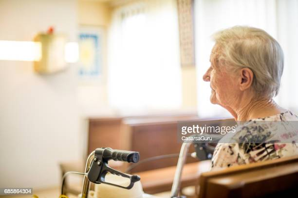 portrait of serene senior woman - chapel stock pictures, royalty-free photos & images