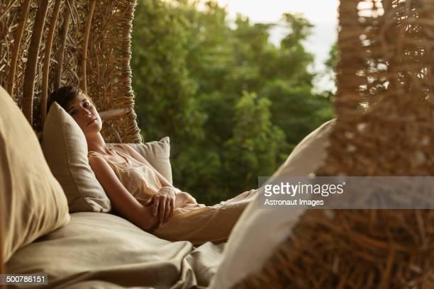 Portrait of serene woman in nest tree house