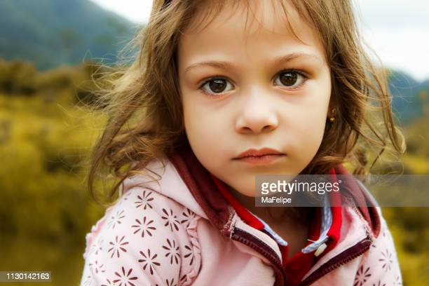 portrait of serious 4-year-old girl looking at camera - small faces stock pictures, royalty-free photos & images