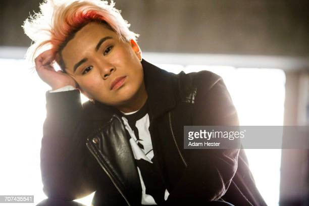 portrait of serious androgynous asian woman - gender fluid stock photos and pictures