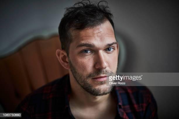 portrait of serious bearded man - ernst stock-fotos und bilder