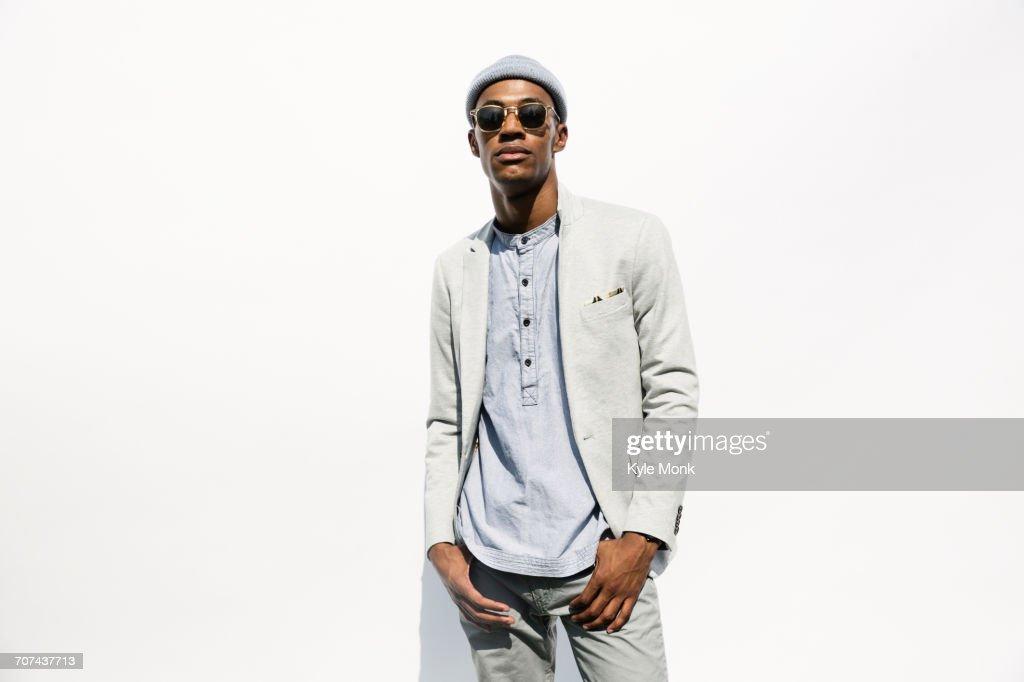 Portrait of serious Black man wearing sunglasses : Stock Photo