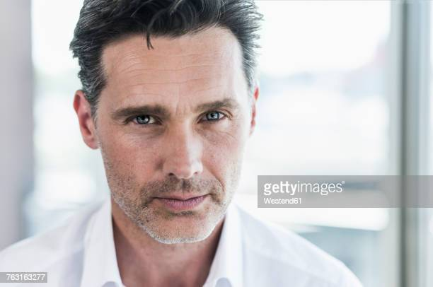 portrait of serious businessman - assertiveness stock pictures, royalty-free photos & images