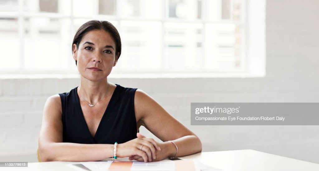 Portrait of serious businesswoman in office : Stock Photo