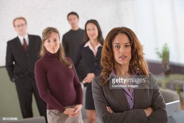 portrait of serious businesswoman with others - category:cs1_maint:_others stock pictures, royalty-free photos & images