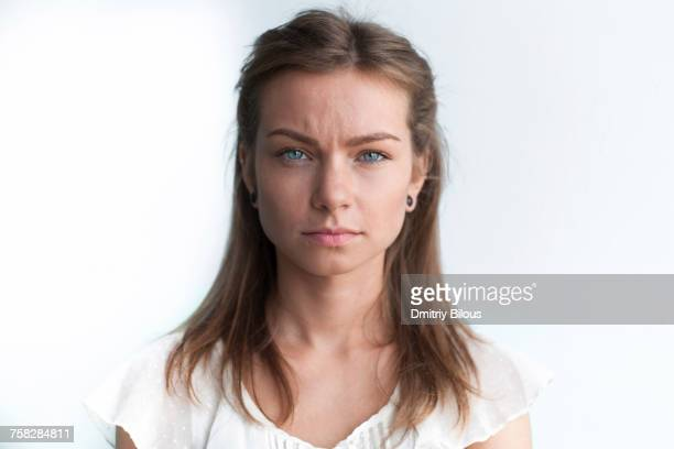 portrait of serious caucasian woman - serious stock pictures, royalty-free photos & images
