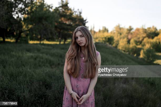Portrait of serious Caucasian woman standing in field