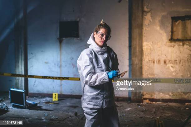 portrait of serious crime scene investigator making notes - crime scene stock pictures, royalty-free photos & images