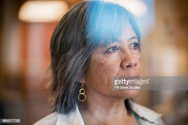 portrait of serious filipino woman - filipino ethnicity and female not male stock pictures, royalty-free photos & images