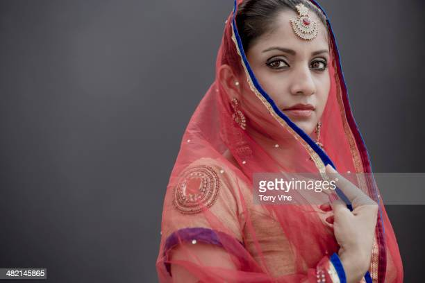 Portrait of serious Indian bride in traditional clothing