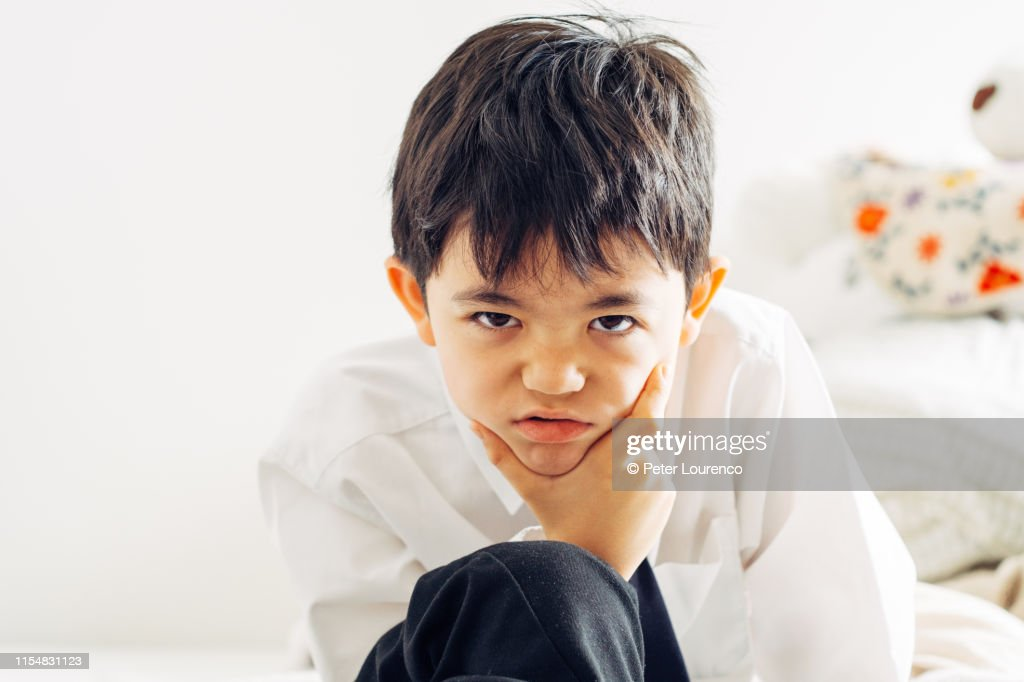 Portrait of serious looking boy : Stock Photo