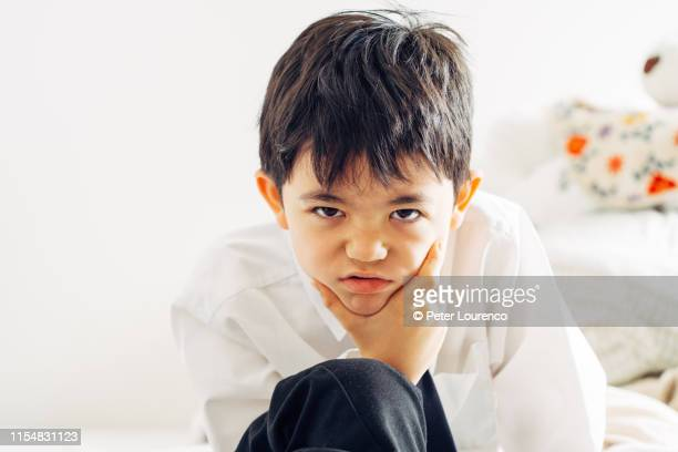 portrait of serious looking boy - peter lourenco stock pictures, royalty-free photos & images