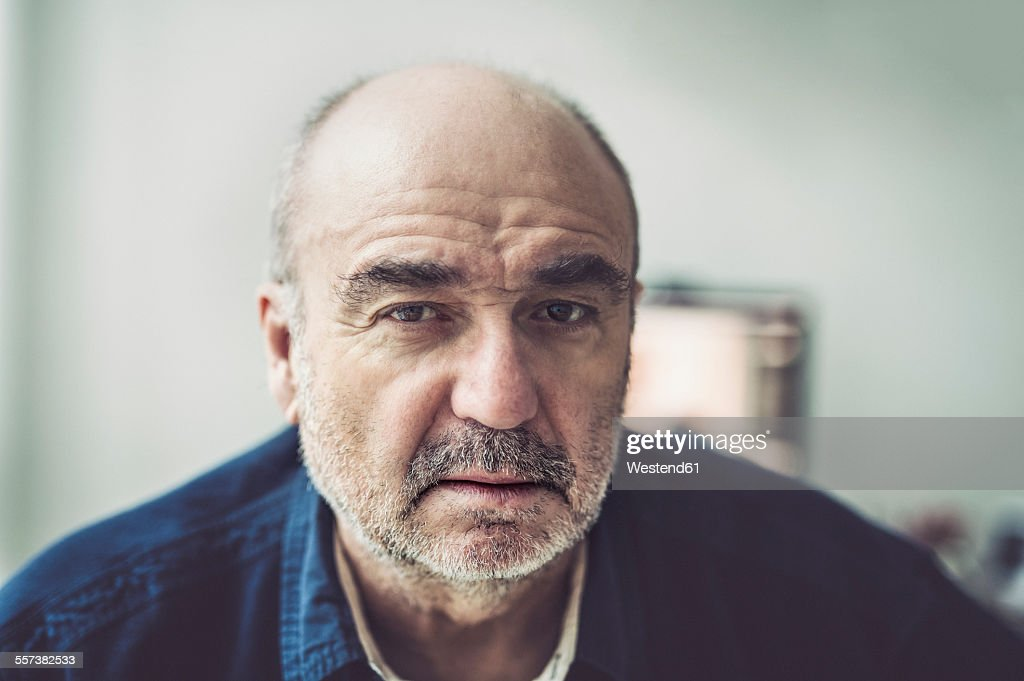 Portrait of serious looking senior man : Stock Photo