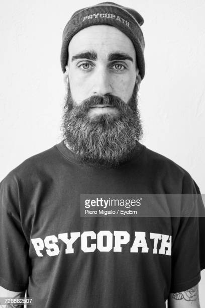 Portrait Of Serious Man Against White Background